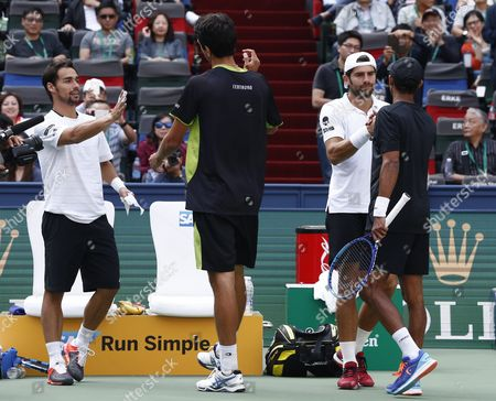 Runners-up Fabio Fognini (l) and Simone Bolelli (3-l) Both of Italy Congratulate Champions Raven Klaasen (r) of South Africa and Marcelo Melo (2-l) of Brazil After the Doubles Final Match in the Shanghai Tennis Masters at the Qi Zhong Tennis Center in Shanghai China 18 October 2015 China Shanghai