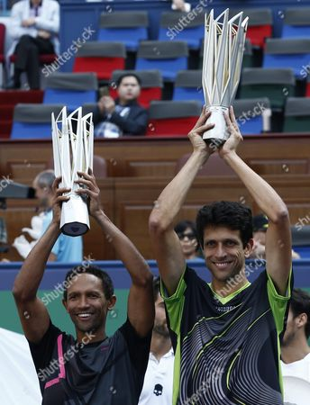Raven Klaasen (l) of South Africa and Marcelo Melo (r) of Brazil Hold Their Championship Trophies After Winning Their Doubles Final Match Against Simone Bolelli of Italy and Fabio Fognini of Italy in the Shanghai Tennis Masters at the Qi Zhong Tennis Center in Shanghai China 18 October 2015 China Shanghai