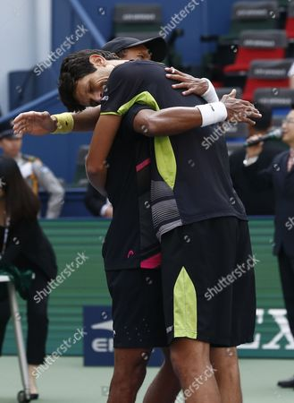 Stock Photo of Raven Klaasen (l) of South Africa and Marcelo Melo (r) of Brazil Celebrate After Winning Their Doubles Final Match Against Simone Bolelli of Italy and Fabio Fognini of Italy in the Shanghai Tennis Masters at the Qi Zhong Tennis Center in Shanghai China 18 October 2015 China Shanghai