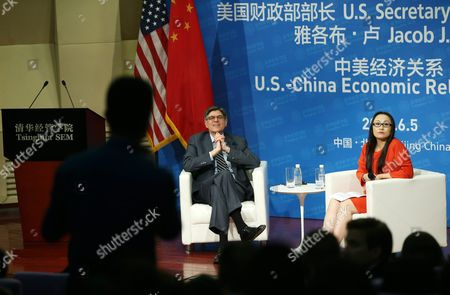 Us Treasury Secretary Jack Lew (c) and Moderator Yang Yanqing Deputy Editor-in-chief of Yicai Newspaper Listens to a Question From a Member of the Audience During a Discussion on Us-china Economic Relations at Tsinghua University School of Economics and Management in Beijing China 05 June 2016 Lew is in Beijing to Participate in the Eighth Us-china Strategic and Economic Dialogue on 6-7 June China Beijing