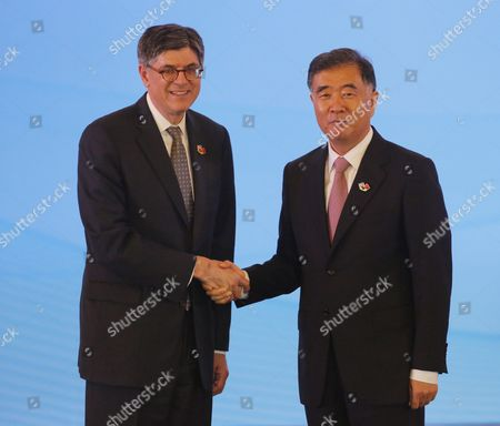 Us Treasury Secretary Jack Lew (l) Shakes Hands with Chinese Vice Premier Wang Yang During the Economic Dialogues of the Eighth Round of the Us-china Strategic and Economic Dialogues at Diaoyutai State Guesthouse in Beijing China 06 June 2016 the 8th Us-china Strategic and Economic Dialogue and the 7th Round of Us-china High-level Consultation on People-to-people Exchange Are Held in Beijing on 06 and 07 June 2016 China Beijing