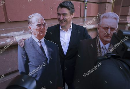 Stock Photo of Croatian Leader of Croatian Social Democratic Party (sdp) Zoran Milanovic Poses with Cut out Paper Figures of Former and Late Yugoslavian Leader Josip Broz Tito (l) and Late Croatian President Franjo Tudjmana (r) in Front of a Polling Station in Downtown Zagreb Croatia 11 September 2016 Croatians Are Voting in Parliamentary Elections to Elect New Authorities For Next Four Years Croatia Zagreb