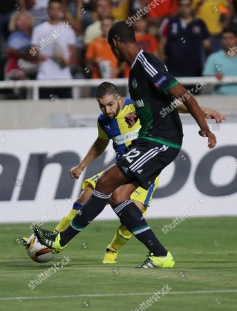 Stock Photo of Constantinos Makridis (l ) of Apoel in Action Against Jo?l Matip (r ) of Schalke During the Uefa Europa League Group K Soccer Match Between Apoel Nicosia and Schalke in Nicosia Cyprus 17 September 2015 Cyprus Nicosia