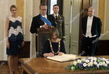Stock Picture of Estonia's New President Kersti Kaljulaid (c Seated) is Watched by Her Husband Georgi-rene Maksimovski (r) Former Estonian President Toomas Hendrik Ilves (2-l) and His Spouse Ieva Ilves (l) During Her Inauguration Ceremony at the Parliament in Tallinn Estonia 10 October 2016 the Estonian 'Riigikogu' Parliament in Tallinn on 03 October 2016 Had Elected the Former Member of the European Court of Auditors with 81 out of 101 Votes As the Country's First Female President Estonia Tallinn