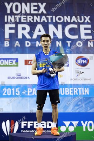 Lee Chong Wei of Malaysia Poses with His Trophy After Winning the Men's Single Final Against Chou Tien Chen of Tapei of the Yonex Internationaux France Badminton at the Stade De Coubertin in Paris France 25 October 2015 France Paris