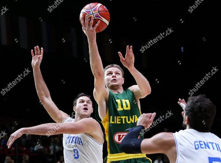 Lithuania's Renaldas Seibutis (c) in Action Against Italian Players Danilo Gallinari (l) and Alessandro Gentile (r) During the Eurobasket 2015 Quarter Final Match Between Italy and Lithuania at the Pierre Mauroy Stadium in Lille France 16 September 2015 France Lille
