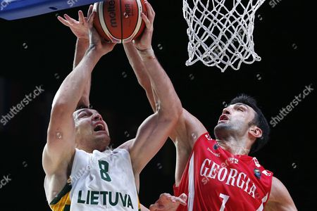 Lithuania's Jonas Maciulis (l) in Action Against Georgia's Zaza Pachulia (r) During the Eurobasket 2015 Round of 16 Match Between Lithuania and Georgia at the Pierre Mauroy Stadium in Lille France 13 September 2015 France Lille