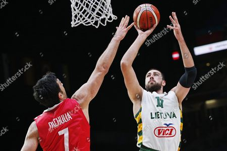 Lithuania's Jonas Valanciunas (r) in Action Against Georgia's Zaza Pachulia (l) During the Eurobasket 2015 Round of 16 Match Between Lithuania and Georgia at the Pierre Mauroy Stadium in Lille France 13 September 2015 France Lille