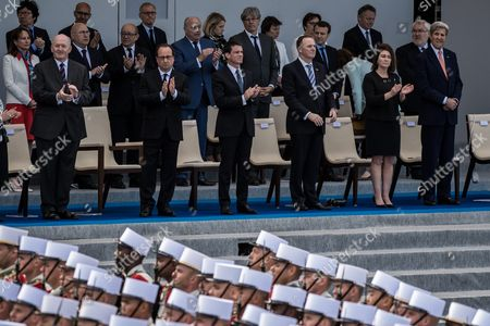 Australian Governor-general Peter Cosgrove (l) French President Francois Hollande (2-l) French Prime Minister Manuel Valls (3-l) New Zealand's Prime Minister John Key (3-r) and Us State Secretary John Kerry (r) During the Traditional Military Parade As Part of the Bastille Day Celebrations in Paris France 14 July 2016 the Bastille Day the French National Day is Held Annually on 14 July to Commemorate the Storming of the Bastille Fortress in 1789 France Paris