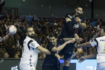 Paris Saint Germain Handball's Nikola Karabatic (c-r) and Samuel Honrubia (c-l) in Action During the Ehf Champions League Handball Match Between Psg and Kiel at the Stade Carpentier in Paris France 21 November 2015 Epa/etienne Laurent France Paris