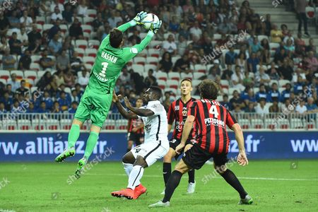 Mouez Hassen of Ogc Nice (l) Vies For the Ball with Jeff Louis of Caen (c) Next to Paul Baysse of Ogc Nice (r) During the French Ligue 1 Soccer Match Between Ogc Nice and Caen at the Allianz Riviera in Nice France 22 August 2015 France Nice