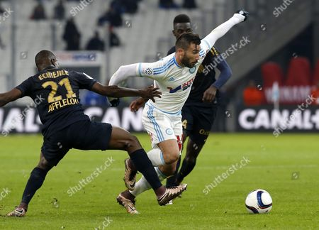 Romain Alessandrini of Olympique Marseille (c) Vies For the Ball with Uwa Echiejile Elderson of As Monaco (l) and Tiemoue Bakayoko (r) During a French Ligue 1 Soccer Match Olympique Marseille Vs As Monaco at the Velodrome Stadium in Marseille Southern France 29 November 2015 France Marseille