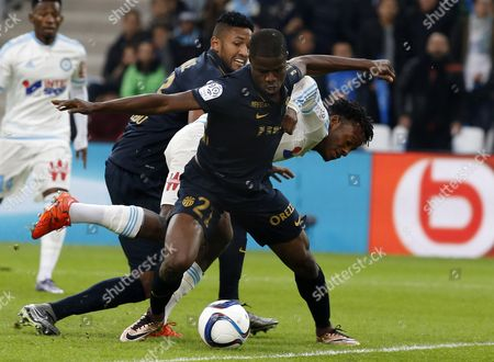 Michy Batshuayi of Olympique Marseille (r) Vies For the Ball with Uwa Echiejile Elderson of As Monaco (c) and Fortunas Dos Santos Wallace (l) During a French Ligue 1 Soccer Match Olympique Marseille Vs As Monaco at the Velodrome Stadium in Marseille Southern France 29 November 2015 France Marseille
