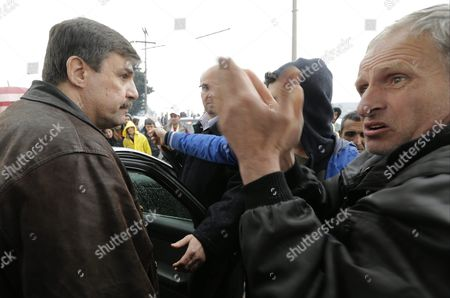 Migrants (r) Talk to Greek Helthcare Minister Andreas Xanthos (l) at the Greek-macedonian Border in Idomeni Greece 23 March 2016 Migration Restrictions Along the So-called Balkan Route the Main Path For Migrants and Refugees From the Middle East to the Eu Has Left Thousands of Migrants Trapped in Greece Greece Idomeni