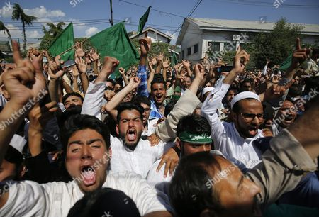Stock Photo of Supporters of Kashmir's Chief Cleric and Chairman of the Moderate Faction of All Parties Hurriyat (freedom) Conference Mirwaiz Moulvi Umar Farooq Shout Slogans During a March in Srinagar the Summer Capital of Indian Kashmir 20 May 2016 Jammu Kashmir Awami Action Committee (jkaac) a Constituent of Aphc is Organising a 'Martyrdom Week' to Mark the Death Anniversary of Mirwaiz's Father Moulvi Muhammad Farooq who was Killed by Unidentified Gunmen on 21 May 1990 India Srinagar