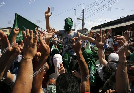 Stock Image of Supporters of Kashmir's Chief Cleric and Chairman of the Moderate Faction of All Parties Hurriyat (freedom) Conference Mirwaiz Moulvi Umar Farooq Shout Slogans During a March in Srinagar the Summer Capital of Indian Kashmir 20 May 2016 Jammu Kashmir Awami Action Committee (jkaac) a Constituent of Aphc is Organising a 'Martyrdom Week' to Mark the Death Anniversary of Mirwaiz's Father Moulvi Muhammad Farooq who was Killed by Unidentified Gunmen on 21 May 1990 India Srinagar