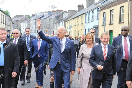Us Vice President Joe Biden (c-l) Irish Prime Minister Enda Kenny (2-r) and His Wife Fionnuala O'kelly (3-r) Walk Together in the Town of Ballina During a Tour in the County of Mayo Ireland 22 June 2016 Biden is on an Offical and Personal Visit to Ireland Ireland Ballina