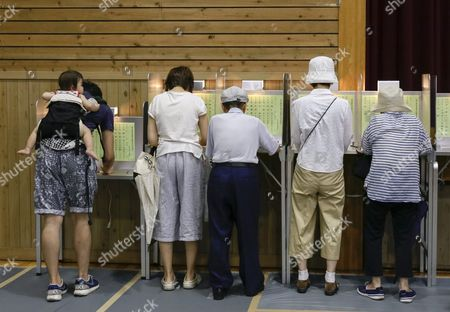 Tokyo Voters Fill Their Ballots For Tokyo Gubernatorial Election at a Polling Station in Tokyo Japan 31 July 2016 the Election is Voted on 31 July to Select the Successor to Yoichi Masuzoe who Resigned Over His Usage of Political Fund About 9 867 000 Voters Select a Governor From 21 Candidates Running For the Gubernatorial Election in the Tokyo Metropolitan with a Population of About 13 617 000 Japan Tokyo