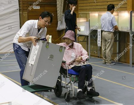 A Woman Voter on a Wheelchair is Assisted by a Staff of Local Electoral Management Committee to Casts Her Ballot For Tokyo Gubernatorial Election at a Polling Station in Tokyo Japan 31 July 2016 the Election is Voted on 31 July to Select the Successor to Yoichi Masuzoe who Resigned Over His Usage of Political Fund About 9 867 000 Voters Select a Governor From 21 Candidates Running For the Gubernatorial Election in the Tokyo Metropolitan with a Population of About 13 617 000 Japan Tokyo