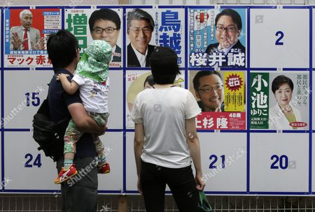 Voters Are Watching Posters of Candidates For Tokyo Gubernatorial Election to Make Their Final Decision Outside a Polling Station in Tokyo Japan 31 July 2016 the Election is Voted on 31 July to Select the Successor to Yoichi Masuzoe who Resigned Over His Usage of Political Fund About 9 867 000 Voters Select a Governor From 21 Candidates Running For the Gubernatorial Election in the Tokyo Metropolitan with a Population of About 13 617 000 Japan Tokyo