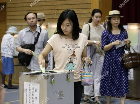 A Tokyo Voter Casts Her Ballot For Tokyo Gubernatorial Election at a Polling Station in Tokyo Japan 31 July 2016 the Election is Voted on 31 July to Select the Successor to Yoichi Masuzoe who Resigned Over His Usage of Political Fund About 9 867 000 Voters Select a Governor From 21 Candidates Running For the Gubernatorial Election in the Tokyo Metropolitan with a Population of About 13 617 000 Japan Tokyo