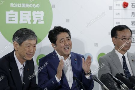 Stock Image of Japanese Prime Minister and the Ruling Liberal Democratic Party (ldp) President Shinzo Abe (c) Gestures As He Speaks Next to the Ldp Vice-president Komura Masahiko (l) and the Ldp Secretary-general Sadakazu Tanigaki (r) During a Media Interview After Putting Red Rose Marks on the Names of the Party's Victorious Candidates in the Upper House Election at the Ldp Headquarters in Tokyo Japan 10 July 2016 the Upper House Election was Held on 10 July and Abe's Liberal Democratic Party and Its Coalition Partner Komeito Won a Majority in the Election Japan Tokyo