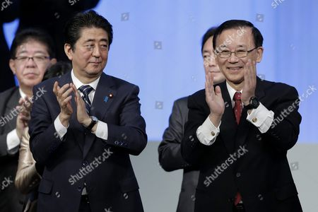 Japanese Prime Minister and President of the Ruling Liberal Democratic Party (ldp) Shinzo Abe (l) and Secretary-general of the Ldp Sadakazu Tanigaki Applaud at the 83rd Annual Convention of the Ldp in Tokyo Japan 13 March 2016 Prime Minister Abe Vowed His Determination to Lead the Party to Victory and Called on the Party Members to Close Ranks For the Forthcoming Upper House Election in the Summer of 2016 Japan Tokyo