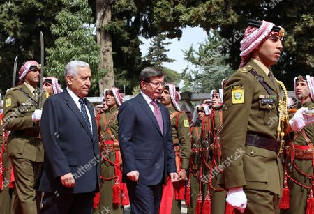 Jordanian Prime Minister Abdullah Ensour (l) and His Turkish Counterpart Ahmet Davutoglu (2-l) Review the Honor Guard During a Welcome Ceremony in Amman Jordan 27 March 2016 Davutoglu is on a Two-day Official Visit to Jordan During Which Time He Will Also Meet King Abdullah Ii of Jordan Jordan Amman