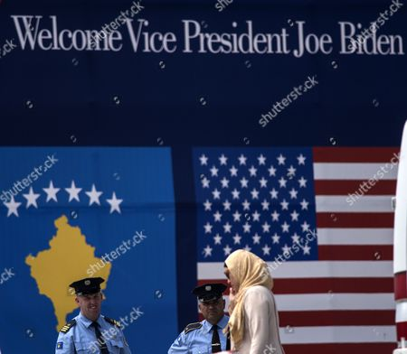 A Woman Walks Past Kosovan Police Officers As They Secure an Area Before the Arrival Us Vice President Joe Biden to a Street Dedication Ceremony Hosted by the Government of Kosovo in Honor of Their Late Son Joseph R 'Beau' Biden Iii Near the Military Camp Bondsteel Kosovo 17 August 2016 Us Vice President Joe Biden and His Wife Dr Jill Biden Arrived on 16 August For a Two-day Visit to Kosovo the Vice President Will Be Participating in Bilateral Meetings with President Hashim Thaci and Prime Minister Isa Mustafa Macedonia, the Former Yugoslav Republic of Ferizai