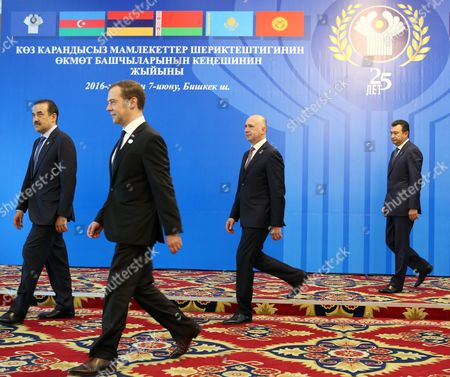 Kazakhstan's Prime Minister Karim Massimov (l) Russia's Prime Minister Dmitry Medvedev (c) and Moldova's Prime Minister Pavel Filip (2-r) Arrive For a Group Photo Opportunity Ahead of a Cis (commonwealth of Independent States) Council of Prime Ministers Meeting in Bishkek Kyrgyzstan 07 June 2016 Kyrgyzstan Bishkek