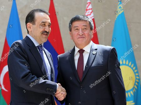 The Prime Minister of Kazakhstan Karim Massimov (l) is Welcomed by Kyrgyzstan's Prime Minister Sooronbai Jeenbekov (r) As They Pose For the Media Prior to a Cis (commonwealth of Independent States) Council of Prime Ministers Meeting in Bishkek Kyrgyzstan 07 June 2016 Kyrgyzstan Bishkek