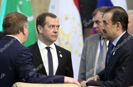 Stock Image of Russian Prime Minister Dmitry Medvedev (2-l) and Prime Minister of Kazakhstan Karim Massimov (r) Arrive For a Cis (commonwealth of Independent States) Council of Prime Ministers Meeting in Bishkek Kyrgyzstan 07 June 2016 Others Are not Identified Kyrgyzstan Bishkek
