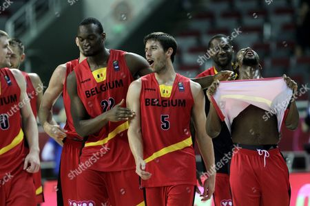 Kevin Tumba (2-l) Quentin Serron (c) Jonathan Tabu (r) and Other Players of Belgium Celebrate Their Victory During the Eurobasket 2015 Match Between Ukraine and Belgium in Riga Latvia 10 September 2015 Latvia Riga
