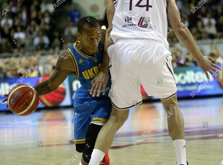 Stock Photo of Jerome Randle (l) of Ukraine and Kaspars Berzins of Latvia During the Eurobasket 2015 Match Between Latvia and Ukraine in Riga Latvia 09 September 2015 Latvia Riga