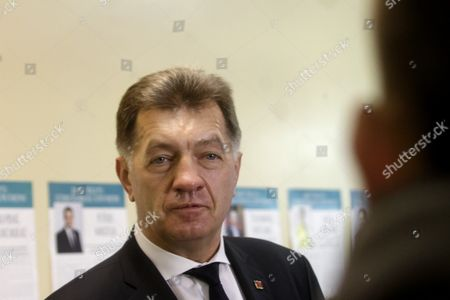 Stock Picture of Leader of Lithuanian Social Democratic Party Lithuanian Prime Minister Algirdas Butkevicius at a Polling Station During Parliamentary Election in Vilnius Lithuania 9 October 2016 Lithuania Vilnius