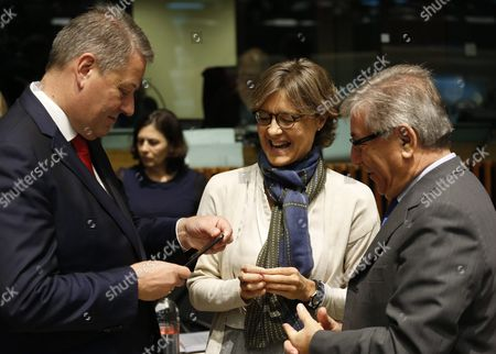 Stock Picture of Austrian Minister of Agriculture Forestry Environment and Water Management Andrae Rupprechter (l) Spanish Agriculture and Fisheries Minister Isabel Garcia Tejerina (c) and Eu Commissioner For Environment Maritime Affairs and Fisheries Karmenu Vella (r) Chat at the Start of the Agriculture and Fisheries Council in Luxembourg 10 October 2016 the Commission Will Present Its Omnibus Proposal and Notably Its Impact on the Main Cap Regulations to the Council Which is Also Due to Agree on Next Year's Fishing Opportunities in the Baltic Sea Luxembourg Luxembourg