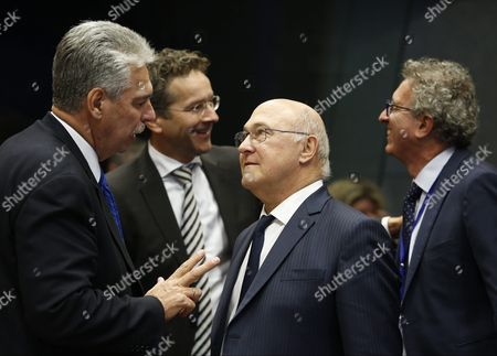 Austrian Finance Minister Hans Joerg Schelling (l) and French Finance Minister Michel Sapin (2-r) at the Start of the Eurogroup Finance Ministers Meeting in Luxembourg 10 October 2016 Luxembourg Luxembourg