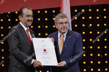 Kazakhstan Prime Minister Karim Massimov (l) Receive the Diploma From International Olympic Committee (ioc) President Thomas Bach (r) During the Presentations by the Candidate Cities For the Third Winter Youth Olympic Games in 2020 at the Convention Centre in Kuala Lumpur Malaysia 31 July 2105 Malaysia Hosts the 128th International Olympic Committee Executive Board Meetings From 28 July to 03 August where Countries Will Be Lobbying who Will Be Host of the 2022 Olympic Winter Games and For the 2020 Youth Olympic Winter Games Malaysia Kuala Lumpur
