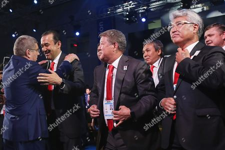 International Olympic Committee (ioc) President Thomas Bach (l) Embraces Kazakhstan's Prime Minister Karim Massimov (2-l) After Announcing Beijing to Win the Rights to Host the 2022 Olympic Winter Games at the Convention Centre in Kuala Lumpur Malaysia 31 July 2105 Beijing was Chosen Over Almaty to Host the 2022 Winter Olympics Following the 128th International Olympic Committee (ioc) Session in Kuala Lumpur Malaysia Kuala Lumpur