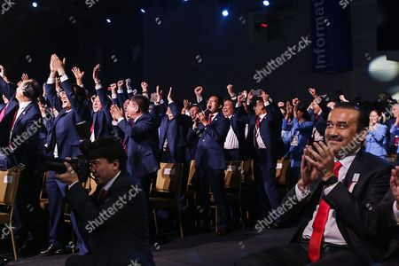 Members of the Chinese Delegation Celebrate As Beijing Wins the Right to Host the 2022 Olympic Winter Games As Kazakhstan Prime Minister Karim Massimov (r) Applauds at the Convention Centre in Kuala Lumpur Malaysia 31 July 2105 Beijing was Chosen Over Almaty to Host the 2022 Winter Olympics Following the 128th International Olympic Committee (ioc) Session in Kuala Lumpur Malaysia Kuala Lumpur