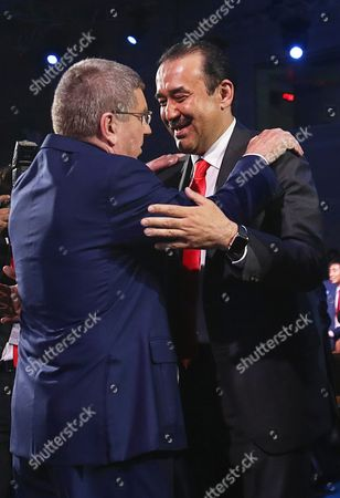 International Olympic Committee (ioc) President Thomas Bach (l) Embraces Kazakhstan's Prime Minister Karim Massimov (r) After Announcing Beijing to Win the Rights to Host the 2022 Olympic Winter Games at the Convention Centre in Kuala Lumpur Malaysia 31 July 2105 Beijing was Chosen Over Almaty to Host the 2022 Winter Olympics Following the 128th International Olympic Committee (ioc) Session in Kuala Lumpur Malaysia Kuala Lumpur