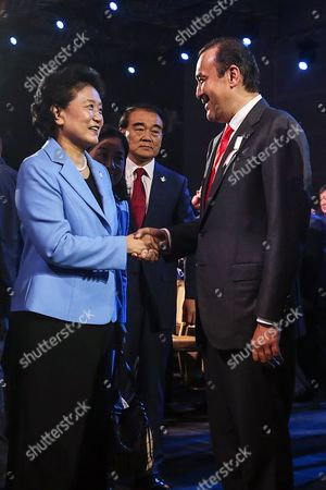 Liu Yandong (l) Vice Premier of State Council of China Shakes Hands with Kazakhstan's Prime Minister Karim Massimov (r) After Beijing was Announced to Win the Rights to Host the 2022 Olympic Winter Games at the Convention Centre in Kuala Lumpur Malaysia 31 July 2105 Beijing was Chosen Over Almaty to Host the 2022 Winter Olympics Following the 128th International Olympic Committee (ioc) Session in Kuala Lumpur Malaysia Kuala Lumpur