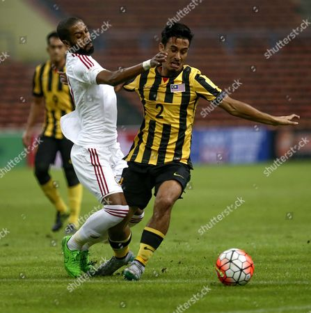 Matthew Davies of Malaysia (r) and Khalid Eisa of Uae (c) in Action During the Fifa World Cup 2018 Asian Qualifying Soccer Match Between Malaysia and Uae at Shah Alam Stadium Outside Kuala Lumpur Malaysia 17 October 2015 Malaysia Kuala Lumpur