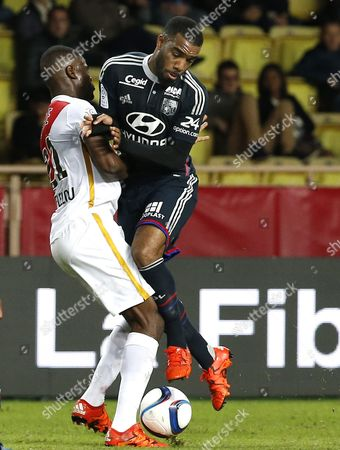 Uwa Echiejile Elderson of As Monaco (l) Vies For the Ball with Alexandre Lacazette of Olympique Lyon (r) During the French Ligue 1 Soccer Match Between As Monaco and Olympique Lyon at Stade Louis Ii in Monaco 16 October 2015 Monaco Monaco