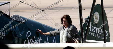 British Aviator Tracey Curtis-taylor Stands Infront of Her Aircraft Upon Arrival For a Stopover at the Karachi International Airport Pakistan 17 November 2015 Curtis-taylor is on a Solo Flight From Britain to Australia in Her 1942 Boeing Stearman Spirit of Artemis Aircraft She Set Off From Farnborough Hampshire and Plans to Fly Through 23 Countries En Route to Sydney Australia a 13 000-mile (20921 Km) Journey That Recreates Pioneering British Aviator Amy Johnson's 1930 Flight Pakistan Karachi