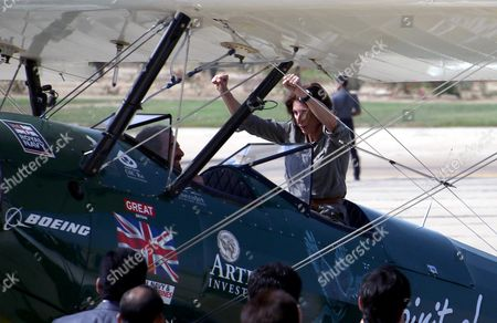 British Aviator Tracey Curtis-taylor Gestures From Her Aircraft Upon Arrival For a Stopover at the Karachi International Airport Pakistan 17 November 2015 Curtis-taylor is on a Solo Flight From Britain to Australia in Her 1942 Boeing Stearman Spirit of Artemis Aircraft She Set Off From Farnborough Hampshire and Plans to Fly Through 23 Countries En Route to Sydney Australia a 13 000-mile (20921 Km) Journey That Recreates Pioneering British Aviator Amy Johnson's 1930 Flight Pakistan Karachi