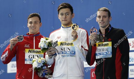 Gold Medalist Yang Sun (c) of China Silver Medalist James Guy (l) of Great Britain and Bronze Medalist Ryan Cochrane of Canada Pose with Their Medals at the Podium During the Award Ceremony of the Men's 400m Freestyle of the Fina Swimming World Championships 2015 in Kazan Russia 02 August 2015 Russian Federation Kazan