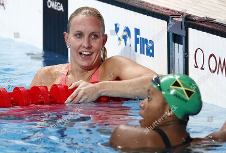 Jessica Hardy of Usa (l) and Alia Atkinson of Jamaica React After the Women's 50m Butterfly Semi Final During the Fina Swimming World Championships at Kazan Arena in Kazan Russia 08 August 2015 Russian Federation Kazan