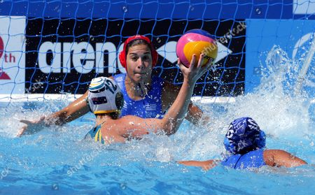 Goalkeeper Eleni Kouvdou (c) of Greece in Action Against Nicola Zagame (l) of Australia During the Women's Water Polo Preliminary Round Match Between Australia and Greece For the Fina Swimming World Championships 2015 in Kazan Russia 26 July 2015 Russian Federation Kazan