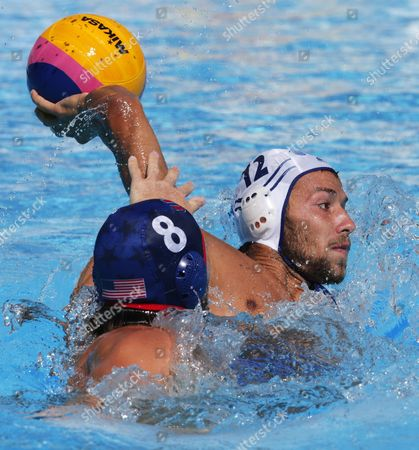 Angelos Vlachopoulos (r) of Greece Vies For the Ball with Tony Azevedo (l) of the Usa During the Preliminary Round of the Men's Fina Water Polo Match Between Greece and Usa of the Fina Swimming World Championships 2015 in Kazan Russia 29 July 2015 Russian Federation Kazan